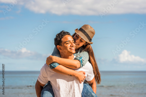 Fotografie, Obraz Young couple in love enjoy happiness and leisure activity - man carry woman in p