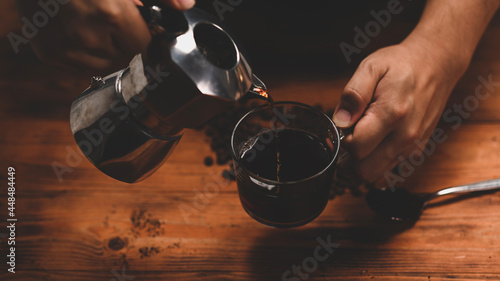 Fotografie, Obraz Barista pouring coffee from moka pot coffee maker.