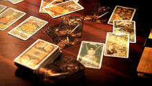 Blurred Tarot Cards On The Table, Esoteric Concept, Fortune Telling Predictions