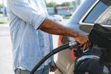 Man Filling Gasoline Fuel In Car At Gas Station