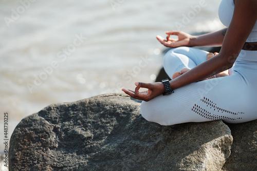 Fotomural Close-up image of fit woman sitting in lotus position enjoying her calm meditati