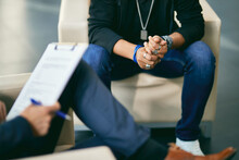 Close-up Of Distressed Black Teenage Boy On Counselling With Psychotherapist.