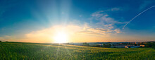 Sunset Panorama On Green Summer Field With Beautiful Sky