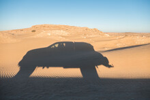 Shadow Of Off Road Truck In Motion In The Desert
