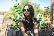 Girl Wearing Green Hearts Sunglasses