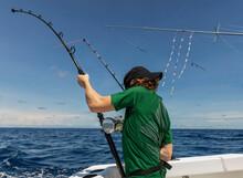 Boy Holding Fishing Rod While  Sportfishing On Boat