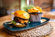 Delicious Hamburger With Cheese And French Fries.