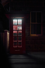 Public Phone Box At Night