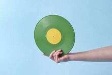 Woman Holding Old-fashioned Green Vinyl Record