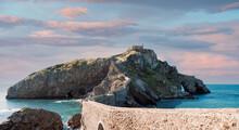 Rocky Island San Juan De Gaztelugatxe Against Sunset Sky Aerial View