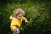 Little Girl Annoyed In A Field