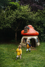 Siblings In A Garden With Gnome House