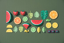 Fruit Made Of Paper. Green Background.