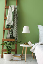 Interior Of Stylish Bedroom With Table And Ladder