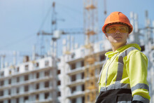 An Engineer In A Green Construction Hoodie And Helmet Manages The Construction Process By Inspecting The Construction Process