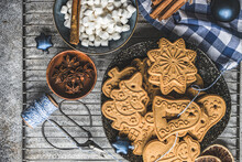 Overhead View Of Assorted Gingerbread Christmas Cookies, Miniature Marshmallows And Spices