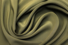 Silk Fabric Crepe De Chine In Khaki In Artistic Layout. Texture, Background. Template.