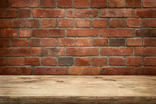 Wooden Table Top With Old Red Brick Wall Background. Place For Produkt.