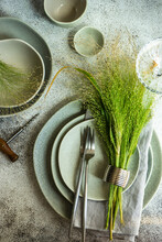 Overhead View Of An Autumnal Rustic Place Setting On A Table With A Wheat Decoration