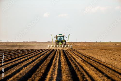 Fotografie, Obraz Farmer seeding, sowing crops at field