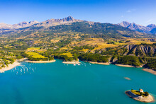 Picturesque View Over Artificial Lake Of Lac De Serre-Poncon In Departments Of Hautes-Alpes And Alpes-de-Haute-Provence, France