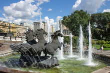 The Famous Fountain In The Historical Center Of The City - Three Bronze Horses And Splashes Of Water On A Clear Summer Sunny Day In Moscow