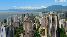 High-rise Apartment Buildings Overlooking English Bay At Daytime In West End, Vancouver, Canada. - Aerial