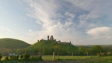 Stunning View Of Corfe Castle Bathed In Early Morning Light.