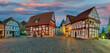 canvas print picture - Marktplatz Obernkirchen beleuchtet Abendrot