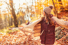Woman Spinning In Circles While Walking Through Forest In Autumn