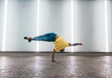 Active Ethnic Breakdancer Doing Handstand