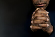 Man Praying To God With Hands Together Caribbean Man Praying With Black Background Stock Photos Stock Photo