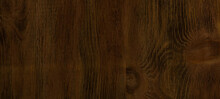 Dark Background Brown Texture Lacquered Wood. Empty Flat Surface. Natural Pattern On The Board. Banner For Advertising