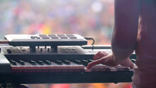Man With Synthesizer Plays Music On The Concert