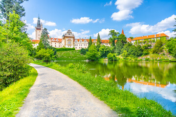 Pruhonice castle and natural park landscape with garden lake on sunny summer day, Pruhenice, Czech Republic. UNESCO World Heritage Site