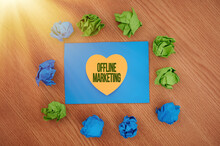 Inspiration Showing Sign Offline Marketing. Internet Concept Advertising Strategy Published Outside Of The Internet Colorful Crumpled Papers Circular Pattern Surrounding Heart Shaped Card.
