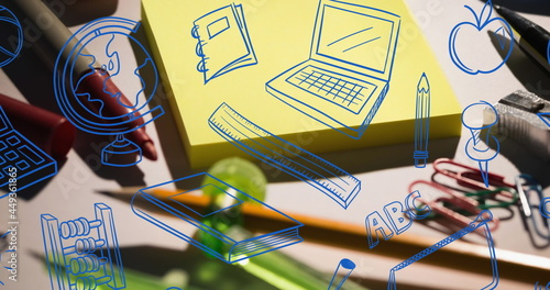 Image of e-learning text over school items icons and desk