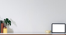 Panoramic View Of Blank Screen Tablet And Decoration Object On White Table With Copy Space.