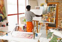 African American Male Painter At Work In Art Studio