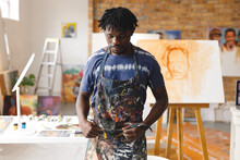African American Male Painter At Work Wearing Apron In Art Studio