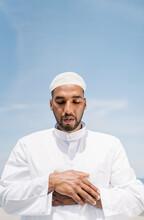 Muslim Man Praying On Beach