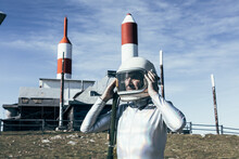 Cosmonaut Against Rocket Shaped Antennas