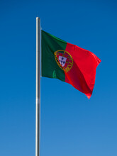 Portuguese Flag On A Blue Sky
