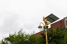Golden Kinnaree Light Bulb And Solar Energy