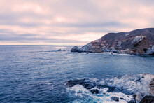 A Cloudy Sunset Looking Out Over Little Harbor, On Catalina Island With A Lone Kayak In The Deep Blue Water