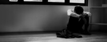 Black And White Tone Of Man Lose A Job Sitting In Room, Dark Sad And Sadness Emotion, Stress And Trouble People Upset And No Job Because Of Covid 19 Or Coronavirus