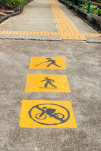 Elderly Pedestrians, Walkway And No Bicycle Allowed Sign On Pavement