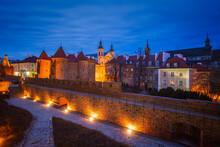 Poland, Masovia, Warsaw, Old City Walls And Barbican Illuminated At Night