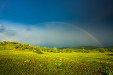 Rainbow Over Fields And Trees On A Farm On The Edge Of Lake