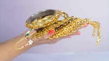 Indian Woman Holding Beautiful Gold Jewelry - Fashion And Style. Gold Loan Against Jewelry And Gold. Personal Saving  Pure Gold Jewelry